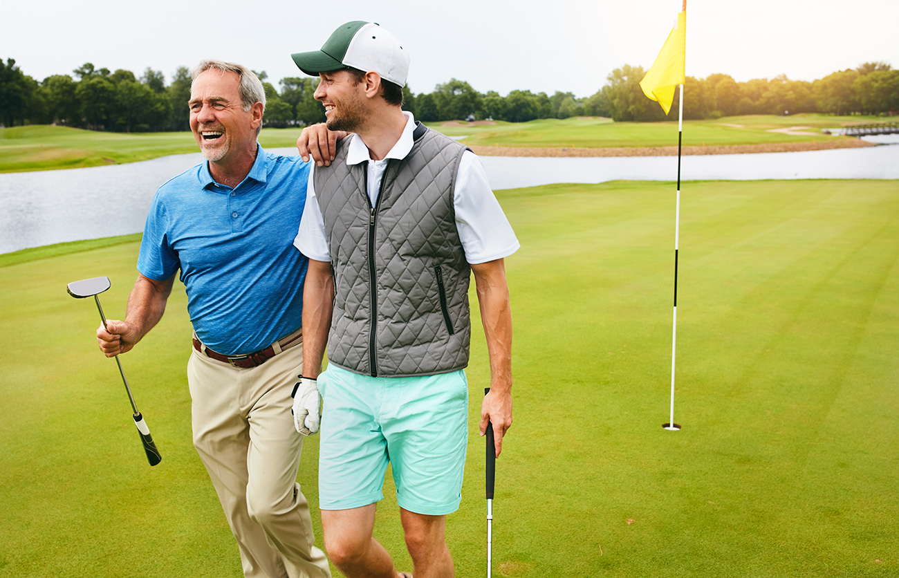 Shot of two friends out playing golf together in their free time